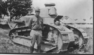 Eisenhower poses next to Renault tank, Camp Meade, Maryland 1919