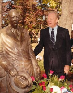 Former President Gerald R. Ford poses by the Eisenhower Statue, 1983