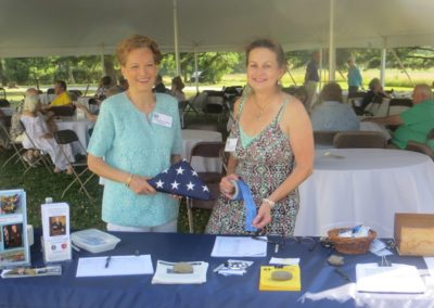 Jacqueline White and Christina Charney greet 2017 picnic guests at the registration table
