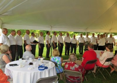 The West Point Alumni Glee Club serenades picnic guests after dinner