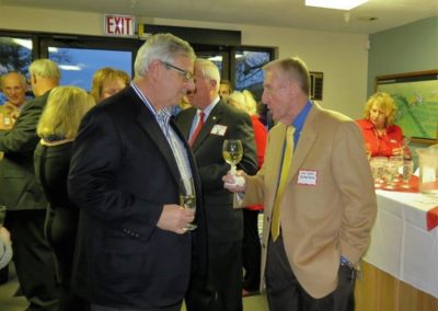 Trustee John Buttlefield (right) engages a guest in conversation